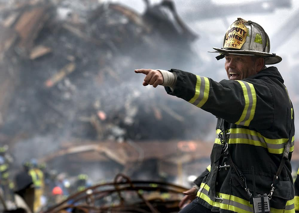 A deputy chief coordinates recovery efforts three days after the collapse of the World Trade Center.