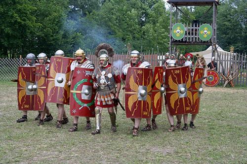 Reenactment of a Roman legion attack with gladius swords and scutum shields. Roman legion at attackWikimedia