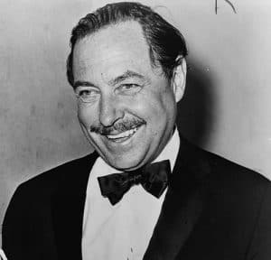 "Tennessee Williams, American playwright; cropped from photo of Williams with cake for 20th anniversary of ""The Glass Menagerie"""